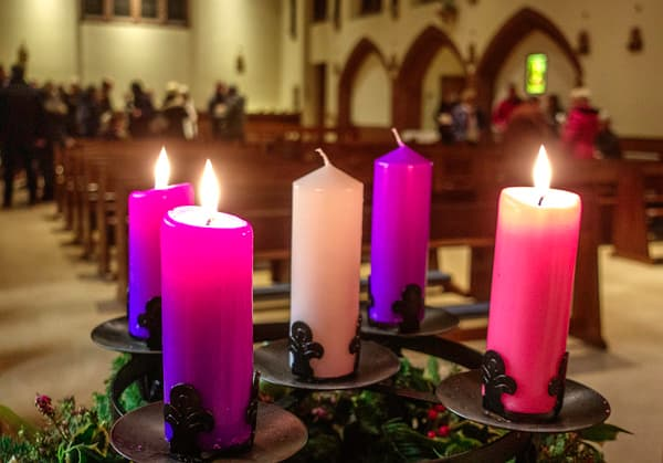 Advent candles with Gaudete Sunday pink candle.